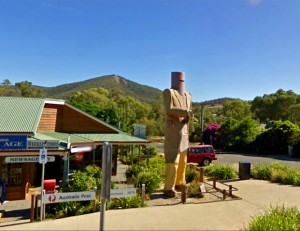 A giant statue of Ned Kelly towers over shops in Glenrowan