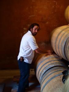 Mr González Sampling Wine from the Barrel