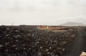 A lonely shipwreck lying in the middle of a lava field along horse trail, Iceland