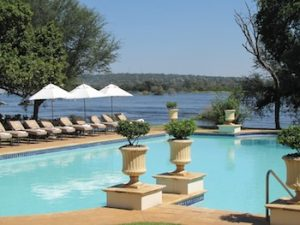 The pool at the Royal Livingstone, with the spray of Vic Falls in the background.