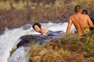 hanging-off-edge-devilspool-vic-falls-cindy-dale