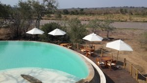 The pool with the river in the background at Azura Selous
